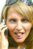 Una mujer loca con el teléfono Imágenes de archivo libres de regalías
