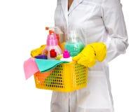 Una mujer más limpia de la criada con la cesta plástica Imagen de archivo libre de regalías