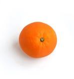 Una naranja en un fondo blanco fotos de archivo
