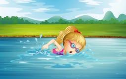 Una natación de la muchacha en el río Imagen de archivo libre de regalías