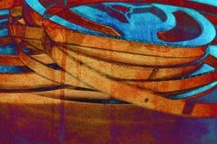 Una natura morta delle bobine della pellicola cinematografica di 8mm sopra un fondo variopinto Fotografia Stock