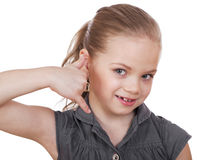 Una niña que me hace una llamada gesto Imagenes de archivo
