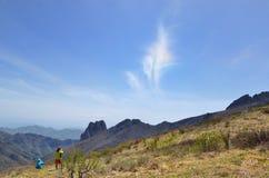 Una nube le gusta una pluma colorida Imagenes de archivo