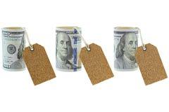 Una nuova banconota indicata unita rotolata di 100 dollari con naturale in bianco Immagini Stock