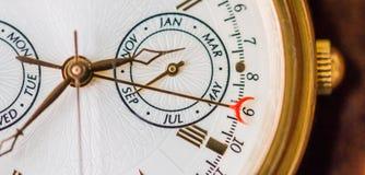 Una opinión de la macro del reloj foto de archivo