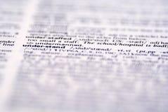 Una palabra ?entiende? en diccionario Fotos de archivo