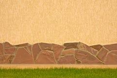 Una pared con una frontera de piedra Imagen de archivo libre de regalías