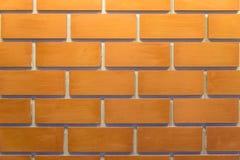Una pared de ladrillos con color acabado con la luz y la sombra Foto de archivo libre de regalías