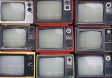 Una pared de televisiones Fotos de archivo libres de regalías