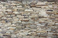 Una pared de una piedra decorativa amarilla salvaje Imagen de archivo