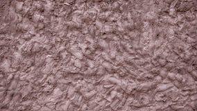 Una parete di fango, fondo decorativo del mastice del cemento, una miscela di terra spalmata sulla terra, un modello di argilla s Immagine Stock