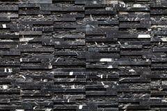 Una parete di pietra nera Immagini Stock