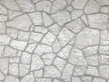 Una parete fatta delle pietre bianche Fondo e dettaglio fotografie stock