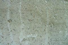 Una parete grigia del cemento come struttura Fotografia Stock Libera da Diritti