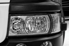 Una parte del faro elegante anteriore automobilistico dell'automobile immagini stock libere da diritti
