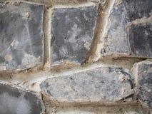 Una parte del fondo di struttura della parete di pietra Immagine Stock Libera da Diritti
