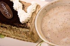 Una parte della torta e del caffè. Fotografia Stock
