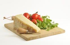 Una paz del parmesam italiano con los tomates Fotos de archivo libres de regalías