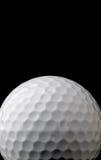una pelota de golf blanca en negro Fotos de archivo libres de regalías