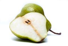 Una pera con una rebanada aislada en blanco Fotos de archivo