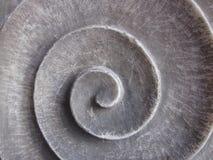 Una piedra espiral redonda gris fotos de archivo libres de regalías