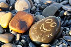 Una pietra piacevole con un fronte dipinto Fotografia Stock