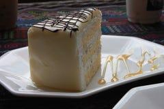 Una pieza de la torta de la leche Fotografía de archivo