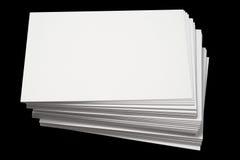Una pila de busines blancos en blanco Fotos de archivo