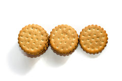 Una pila de crema del bocadillo del soplo de las galletas del cicle aislada en blanco fotos de archivo libres de regalías