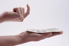 Una pila de efectivo en la mano Fotos de archivo