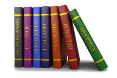 Una pila de libros en el estudio de idiomas Fotos de archivo libres de regalías
