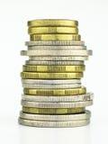 Una pila de monedas Imágenes de archivo libres de regalías