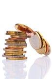 Una pila de monedas Foto de archivo libre de regalías