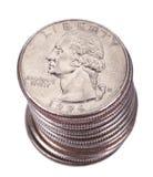 Pila aislada de la moneda del dólar cuarto Fotografía de archivo libre de regalías