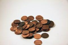 Una pila de peniques de cobre Imágenes de archivo libres de regalías