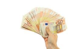 Una pila della tenuta della mano di cinquanta euro note su bianco Fotografie Stock Libere da Diritti