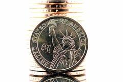Una pila di monete di un oro del dollaro Fotografie Stock Libere da Diritti