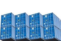 Una pila di sei contenitori del mare del blu Fotografie Stock