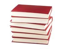 Una pila di sei libri rossi Immagine Stock