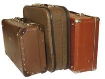 Una pila di tre valigie d'annata isolate Fotografie Stock