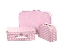 Una pila di tre valigie, rosa con i punti bianchi  Fotografia Stock Libera da Diritti