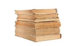 Una pila di vecchi libri isolati Fotografie Stock Libere da Diritti