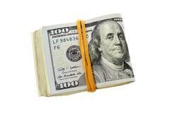 Una pila piegata di cento dollari di fatture Immagine Stock