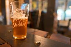 Una pinta di birra Fotografie Stock