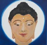 Una pintura, ejemplo de una cabeza de Buda en un fondo azul y blanco Fotos de archivo