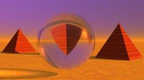 Una pirámide upside-down en una esfera y dos otras Fotos de archivo