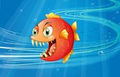Una piraña roja debajo del mar stock de ilustración