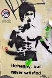 Una pittura dei graffiti di arte della via che rappresenta artista marziale Bruce Lee a Londra fotografia stock