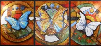 Una pittura a olio di tre farfalle multicolori nei settori separati fotografie stock libere da diritti