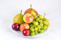 Una placa con las frutas Imagen de archivo libre de regalías